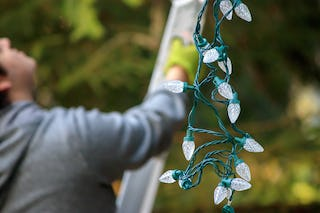 Even today hanging Christmas lights take a bit of effort.