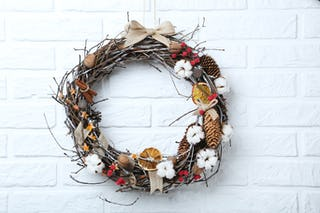 Wreaths of dried wood, fruits and pine cones are a popular alternative to the classic greenery.