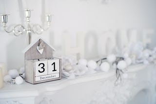 Calendar on a White Mantel