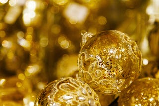 Gold Ornaments Sparkling by the Tree