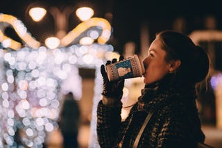 Woman Drinking Holiday Latte