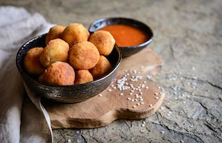 A tasty Italian treat, arancini balls will wow your guests.
