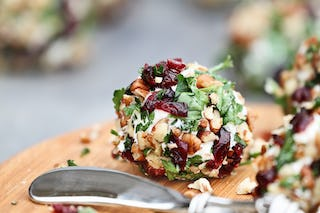 Cheese balls look a lot like Christmas ornaments, making them the perfect holiday appetizer.