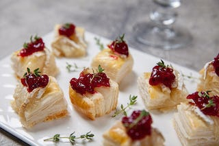 Pairing tart cranberries with rich brie makes for a lip-smacking good nibble.