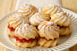 Spritz cookies, a classic german confection, can double as a mnini-cookie-sandwich.