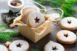 Between their powdered layers Linzer cookies hide a jammy center.