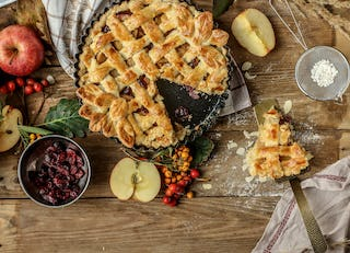 A slice of Christmas apple pie with cranberries brightens everyone