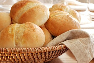 Hot and fresh Christmas dinner rolls in a basket.