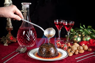 Christmas pudding covered in flaming brandy.