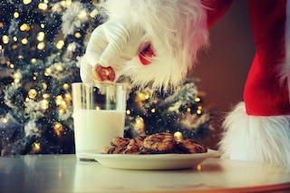 Santa partaking in some milk and cookies.